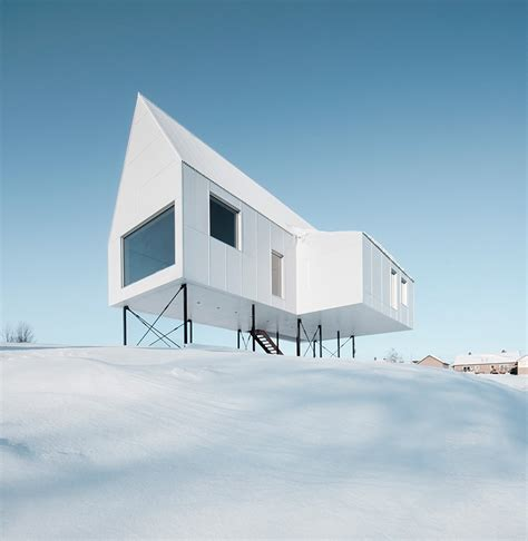 delordinaire elevates high house  snow covered