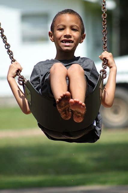 photo kid boy swinging young swing  image
