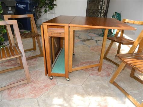 Hideaway Table And Chairs Set by Hide Away Dining Set 4 Folding Chairs W Console