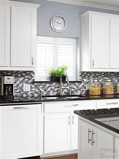 kitchen tiles color a pop of purple adds subtle color to this gray glass tile 3319