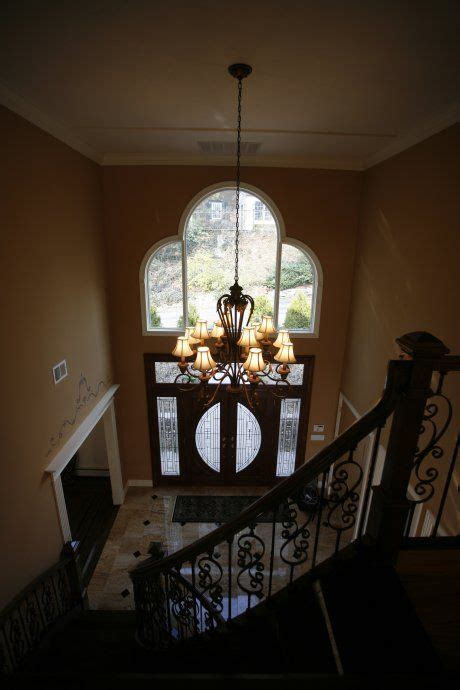 chandelier for entrance foyer the high ceiling entrance and chandelier home