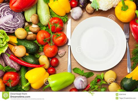 Fresh Photo by Fresh Organic Vegetables Around White Plate With Knife And