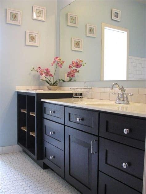 light blue bathroom  white countertop subway tile