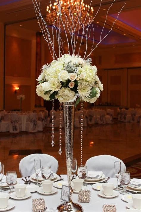 winter wedding centerpiece  tall silver vase  silver