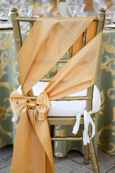 gold chair sashes with sage and gold chopin table linens
