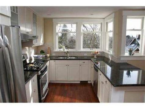 white kitchen cabinets with dark countertops contemporary kitchen with white cabinets and black