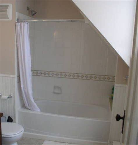 shower curtain sloped wall hang an additional swag on the