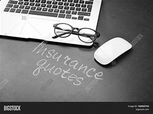 Text INSURANCE QUOTES, laptop and glasses on blackboard background Stock Photo & Stock Images ...
