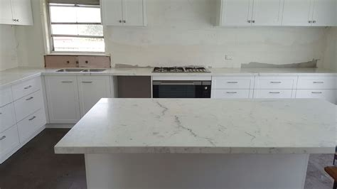 white kitchen island with granite top miele honed marble kitchen benchtop