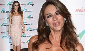 Elizabeth Hurley Flashes Her Ample Assets In Boob Tube