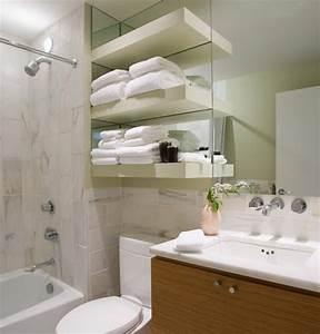 Black wooden free standing bathroom shelf over toilet