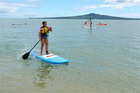 People Paddle Boarding In Mission Bay In Auckland New