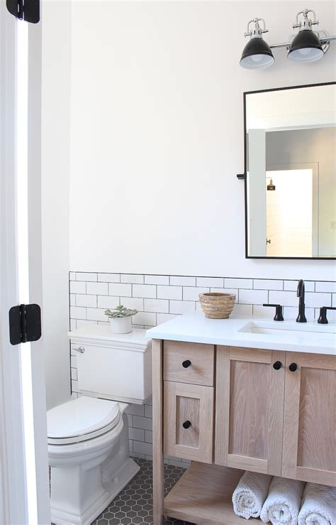 a classic white subway tile bathroom designed by our