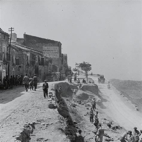 troops and vehicles entering centuripe after its fall to