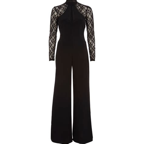 lace jumpsuit black river island lace sleeve flared jumpsuit in black lyst