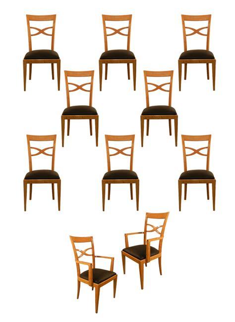 ad 811 suite de 2 fauteuils et 8 chaises en bois clair de