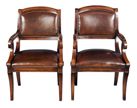 pair of antique style mahogany leather desk chairs