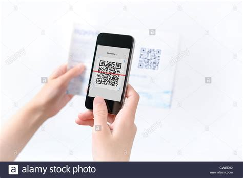 Woman Scanning Qr Code In The Magazine On Mobile Smart