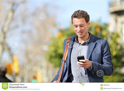 young urban businessman professional  smartphone stock