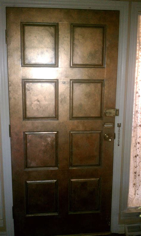 ordinary wood door faux painted to look like copper fun