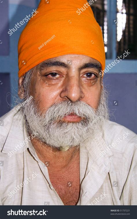 September 22: Old Sikh Devotee With Orange Turban
