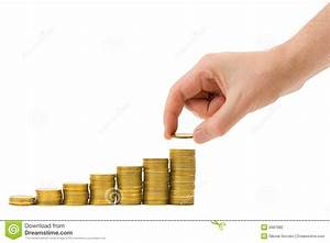 Hand Put Coin To Money Staircase Stock Photo