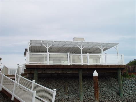 deck with glass railing and patio cover mid cal construction