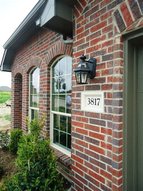 village homes     details deep red brick  greygreen accents village homes