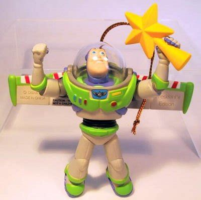 buzz lightyear holding yellow star tree topper ornament