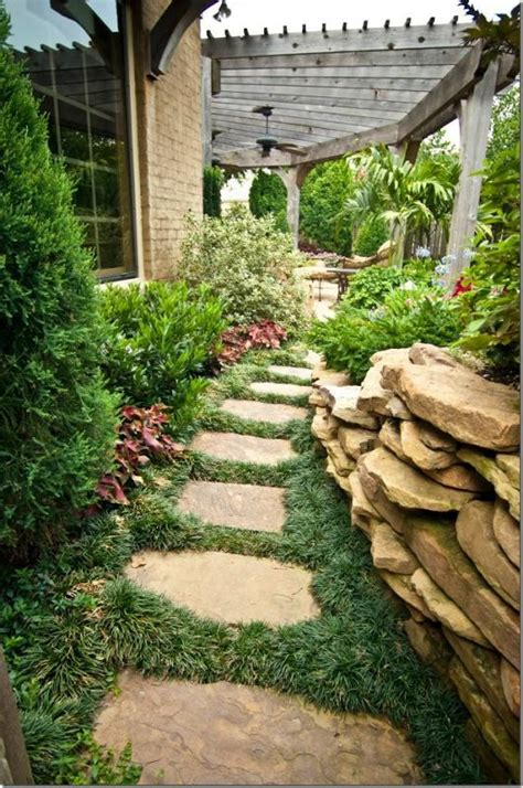 small side yard landscaping ideas mondo grass between stepping stones garden landscapes pinterest flag stone side yards and