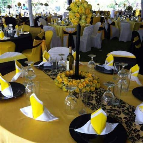 yellow black gold themed wedding decorations at paya