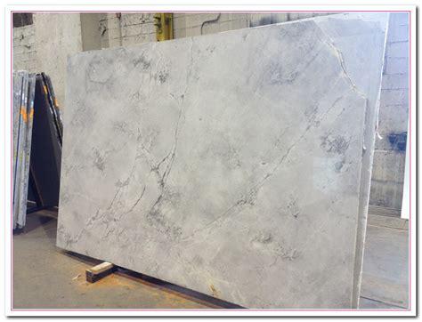 working on white granite countertop for luxury kitchen
