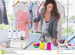 Fashion Designer Measuring A Mannequin Stock Photo