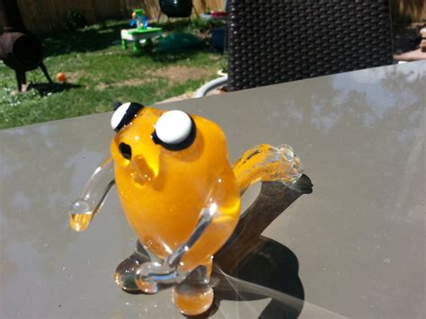 adventure time jake  dog sherlock smoking pipe geekologie