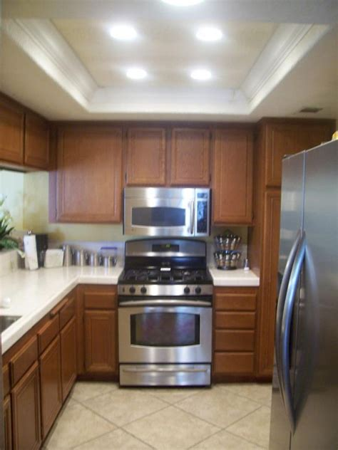 changing a ceiling fan replace the ugly fluorescent lighting remodel kitchen