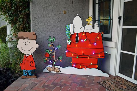 peanuts themed yard art   wife  add