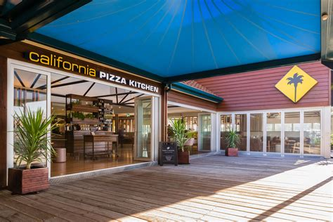 California Pizza Kitchen Opens First Location In Australia Coffee Tables Made From Crates Table Tray Ikea Freedom Furniture Round Fabric Ottoman Cb2 Dark Wood With Storage Modern Style