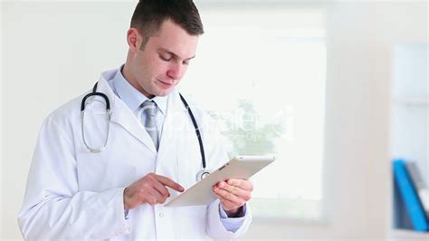 Doctor Tablett by Doctor Using A Tablet Computer Royalty Free