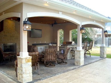 House Patio by Pool House With Outdoor Kitchen Fireplace In Cypress
