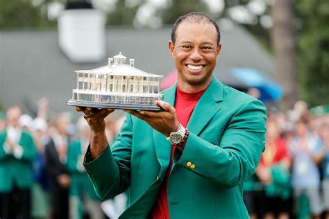 Tiger Woods celebrates during the trophy presentation ...