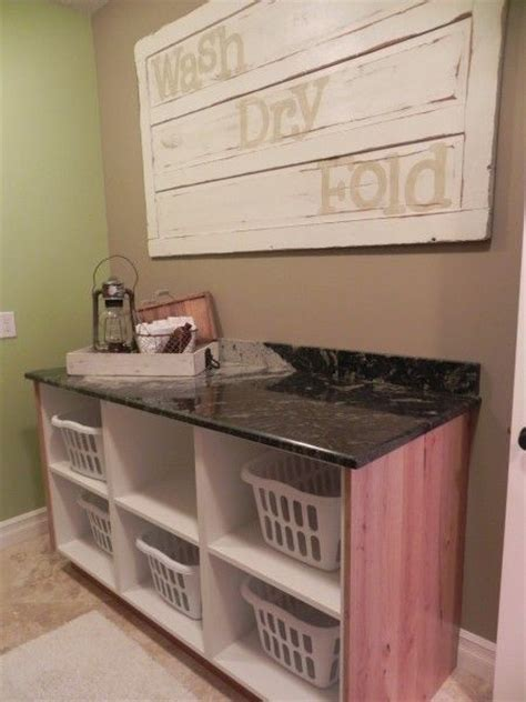 laundry room table with storage pin by just cabinets furniture more on laundry rooms