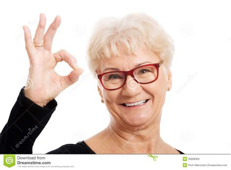 Happy Old Woman In Eye Glasses Showing Ok Stock Image