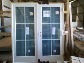 glass doors grass handrail iron railing lawn outdoor