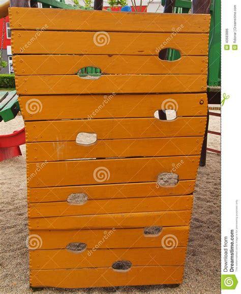 orange wooden climbing wall ladder  kids playground