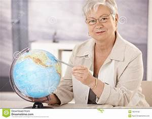 Senior Teacher Teaching Geography Stock Photo