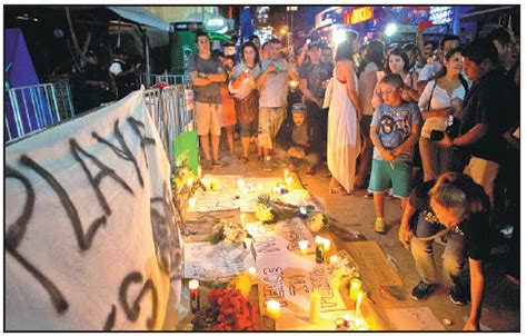 local residents gather  place candles  banners