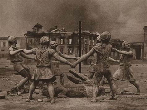 ww2 photo of statue in stalingrad children around an