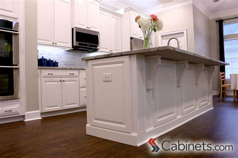 the kitchen cabinet panel decorative end panels and corbels finish this kitchen