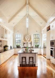 this kitchen vaulted ceiling wood floors white cabinets