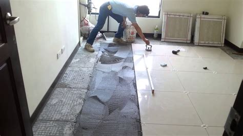 How To Install Floor Tile In Bathroom by Floor Tile Installation Polished Porcelain 60x60cm